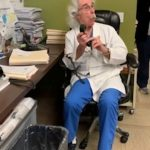 Heartwarming moment fertility doctor and clinic staff call up IVF couple to chorus: 'You're pregnant!'